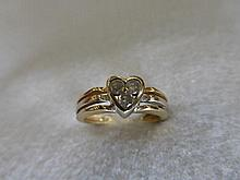 A 9ct white and yellow gold ring with heart motif,