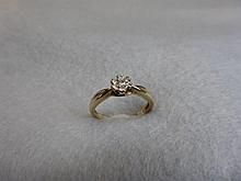 A 9ct gold diamond solitaire ring.
