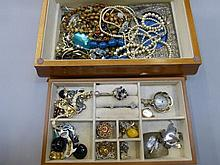 A box of assorted costume and other jewellery.