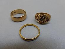 A 22ct gold wedding band, an 18ct gold band and a