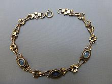 A 9ct gold and opal set bracelet.