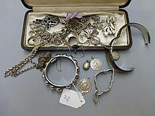 A quantity of silver and costume jewellery.