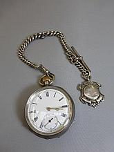 A silver pocket watch on chain and fob.