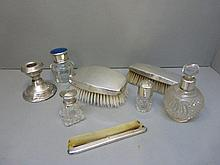 An assortment of silver topped scent bottles, a
