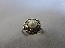 An Art Deco 9ct white gold cultured pearl ring.