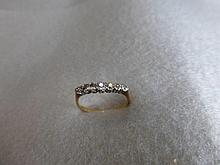 A Victorian 18ct gold seven stone old cut diamond