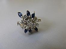 A 14ct white gold diamond and sapphire ring of