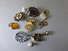 An assortment of brooches and fobs including