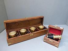 A boxed set of four shot glasses in the form of