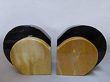 A pair of Art Deco marble bookends, together