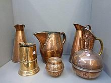 Four 19th Century copper jugs, a copper tankard