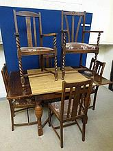 An oak drawleaf table and six chairs (4+2).