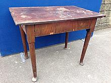 An 18th Century mahogany side table on circular