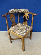 A 19th Century oak upholstered corner elbow chair