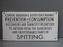 A reproduction cast metal 'Spitting' sign.