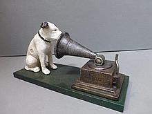 A reproduction cast metal HMV dog with gramophone.