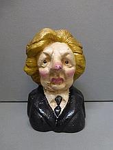 A cast metal bust of Margaret Thatcher.