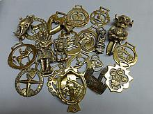 A collection of brass door knockers and horse