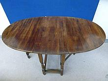 An oak oval gateleg table.