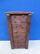 A Victorian mahogany wellington chest of seven