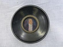 A miniature portrait of a 19th Century gentleman.