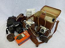An assortment of cameras including a Minolta Dynax