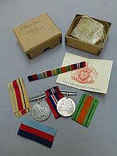 A collection of WWII memorabilia and medals
