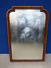 A Victorian walnut framed wall mirror.