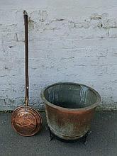 A large 19th Century copper log bin and stand and