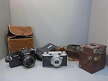 Six assorted cameras, various ages including a