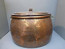 A large twin handled 19th Century copper pan and