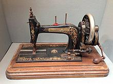 A walnut cased sewing machine.