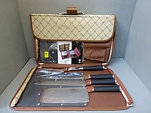 A Waltmann nine piece knife set in a carrying