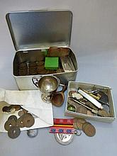 An assortment of coinage and mixed collectables.
