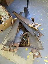 An assortment of moulding planes and saws.