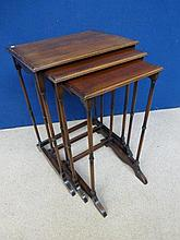 An Edwardian mahogany nest of three tables raised