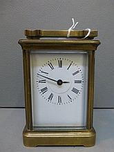 A 19th Century brass carriage clock.