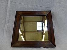 A square rosewood framed wall mirror.