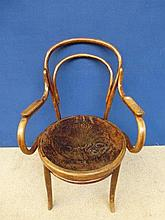 An early 20th Century bentwood elbow chair with