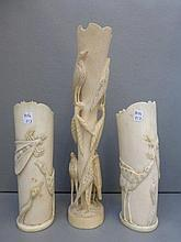 A pair of late 19th Century ivory vases decorated