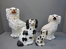 Four 19th Century Staffordshire spaniels, various