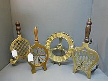 Four 19th Century brass fireside trivets.