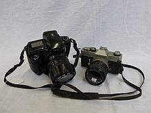 A Canon TX camera and a Canon 35mm SLR E055 zoom