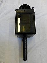 A carbine coaching lantern with maker's label: