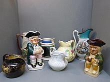 Six assorted jugs including Majolica and
