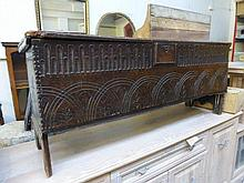An 18th Century carved oak coffer with internal