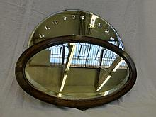 A decorative circular wall mirror and an oak