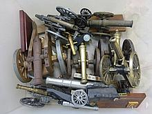 A box of assorted model cannons.