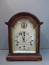 A mahogany dome topped mantle clock with