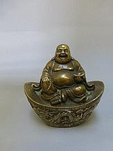 A decorative brass cast figure of a seated Buddha.